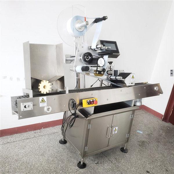 Automatický stroj na označování kulatých lahví vína