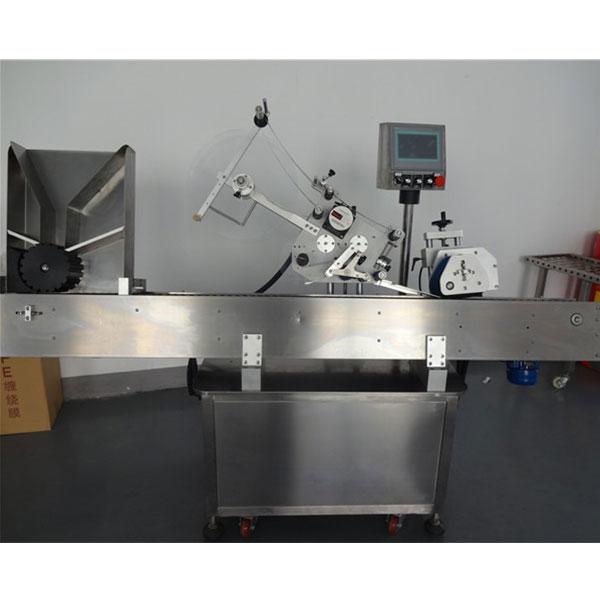 Automatický stroj na označování lahviček s kulatými lahvemi