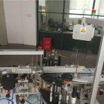 Stroj na označování plastových lahví pro kosmetický průmysl
