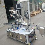 Samolepicí štítkovací stroj pro elektrický pohon s tryskovým pouzdrem